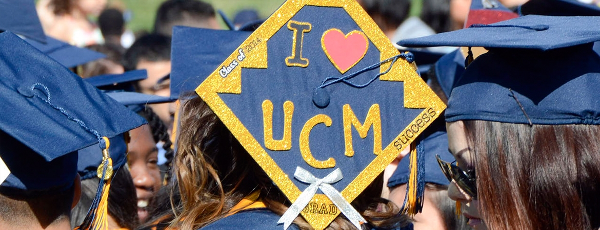 UC Merced graduate's hat decorated for commencement.